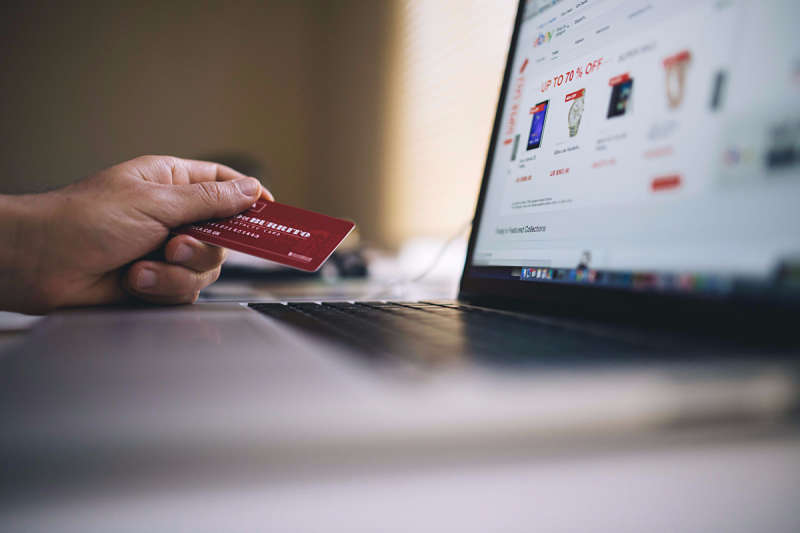 Picture of someone using a credit card for online shopping
